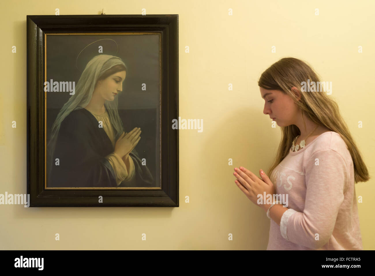 Young woman praying like the portrait of the Blessed Virgin Mary ...