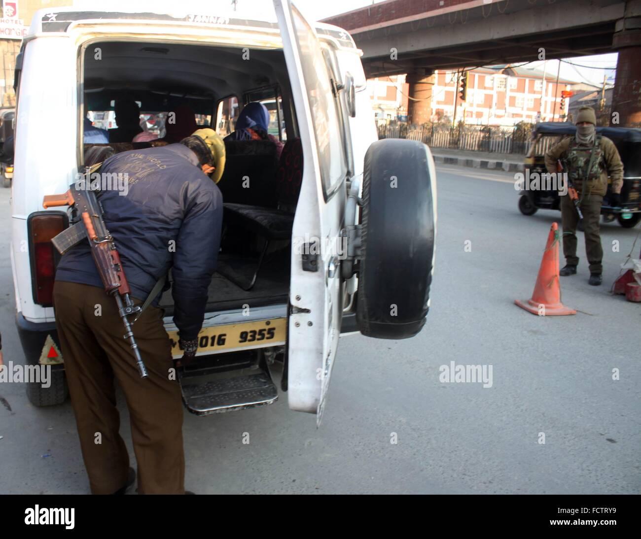 Indian police men checks a passenger vehicle near a temporary Stock ...