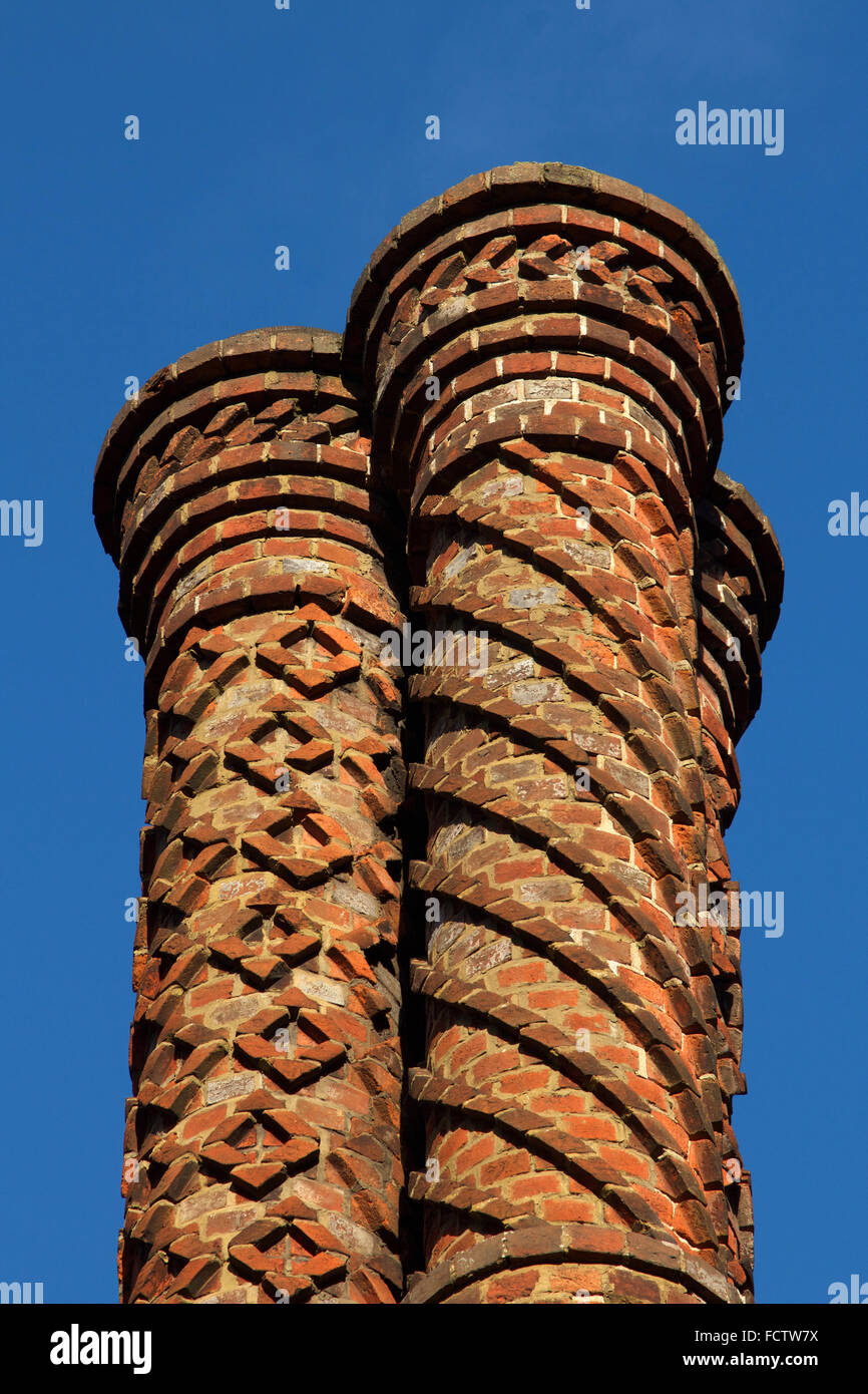 Chimneys on The Old Post House, in Albury, Surrey, UK - 19th century copies of Tudor designs by the architect Augustus - Stock Image