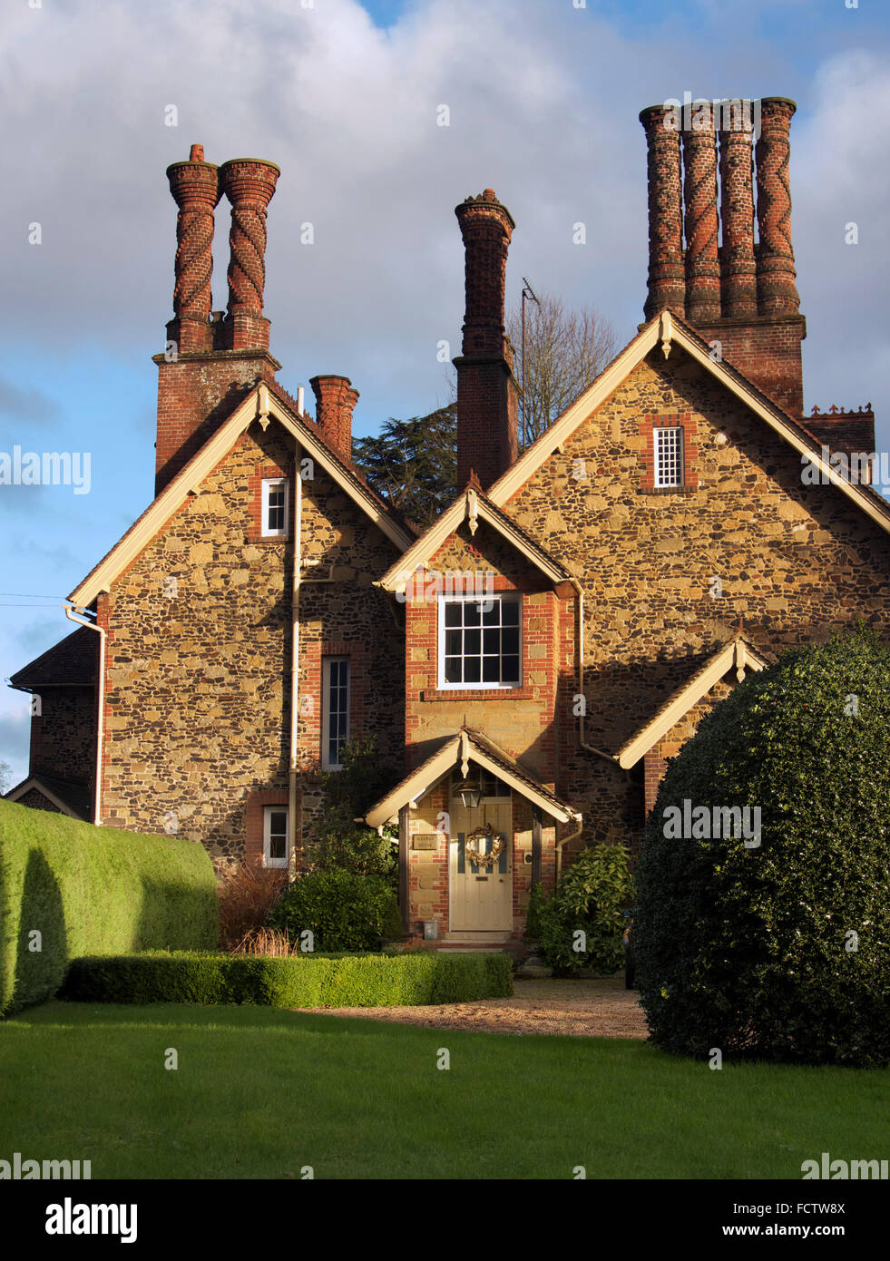 The Old Coach House, in Albury, Surrey, UK with the famous Pugin chimneys - 19th century copies of Tudor designs. - Stock Image