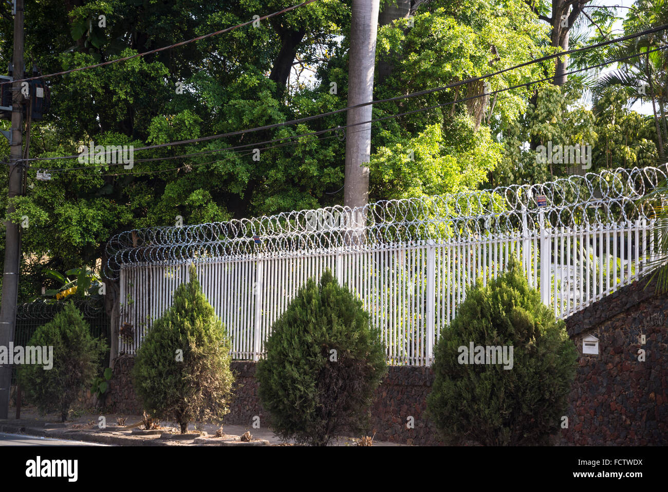 Barbed wire fence of wealthy residential property, Pampulha, Belo Horizonte, Minas Gerais, Brazil - Stock Image