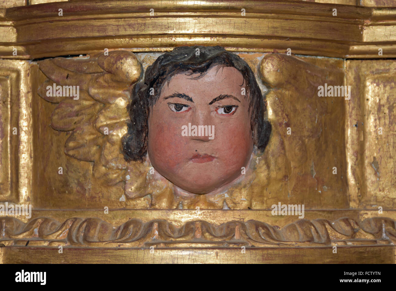 Face in altarpiece of Eglise de Diusse, France - Stock Image