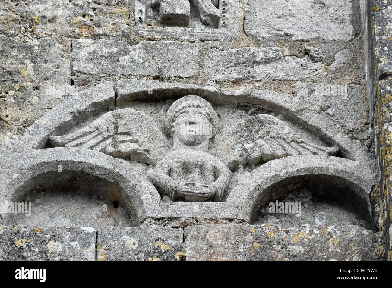 Angel on the facade of Sainte Colombe church, Charentes, France - Stock Image