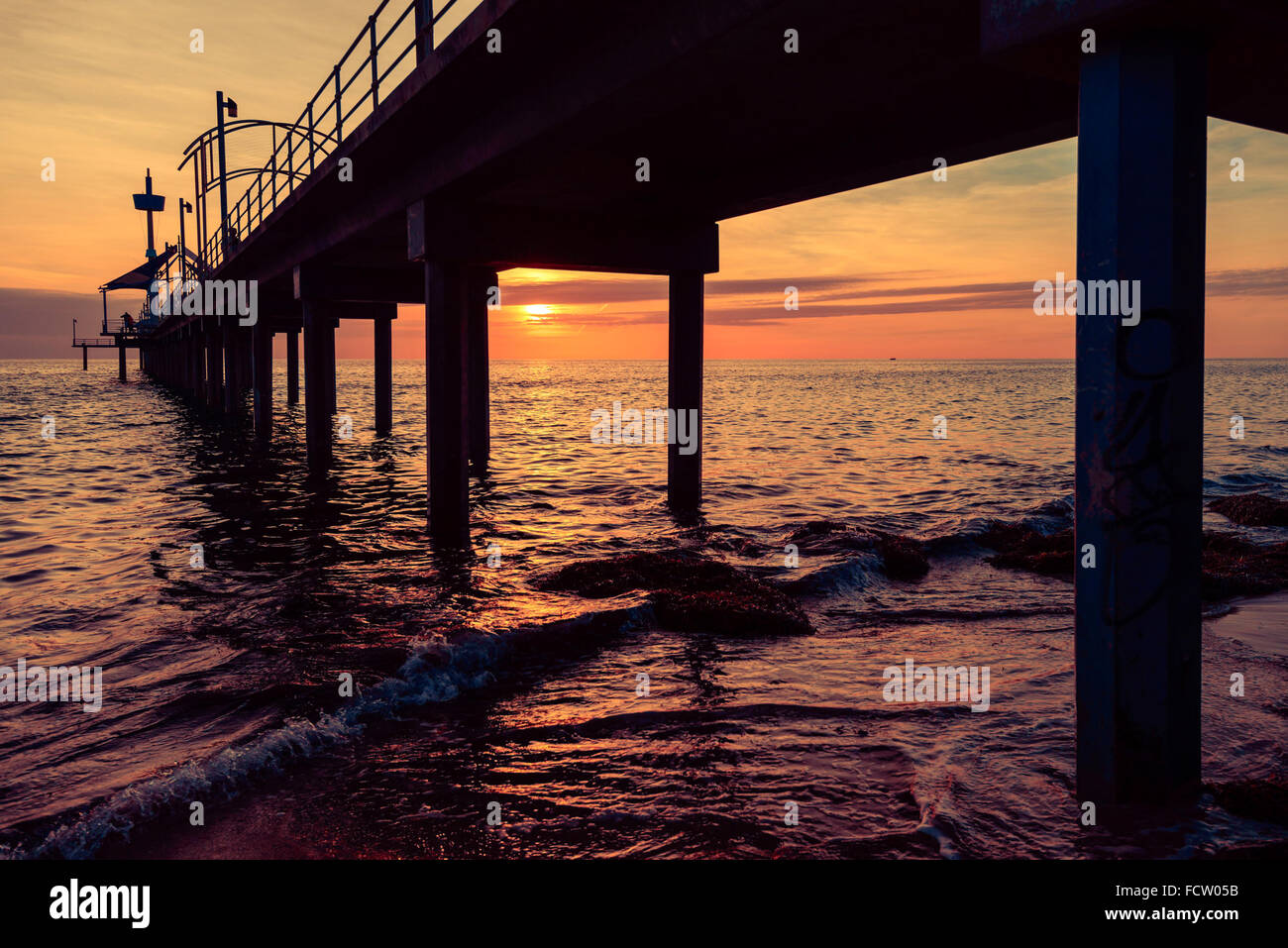 Brighton jetty sunset, South Australia. Colour toning effects applied - Stock Image