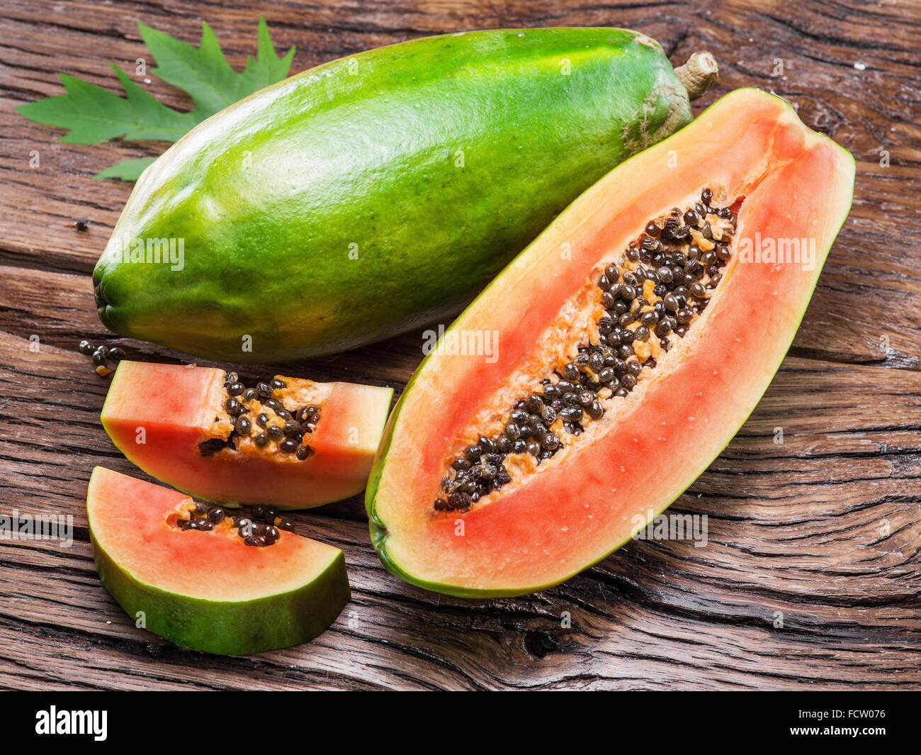 Papaya fruit on wooden background. - Stock Image