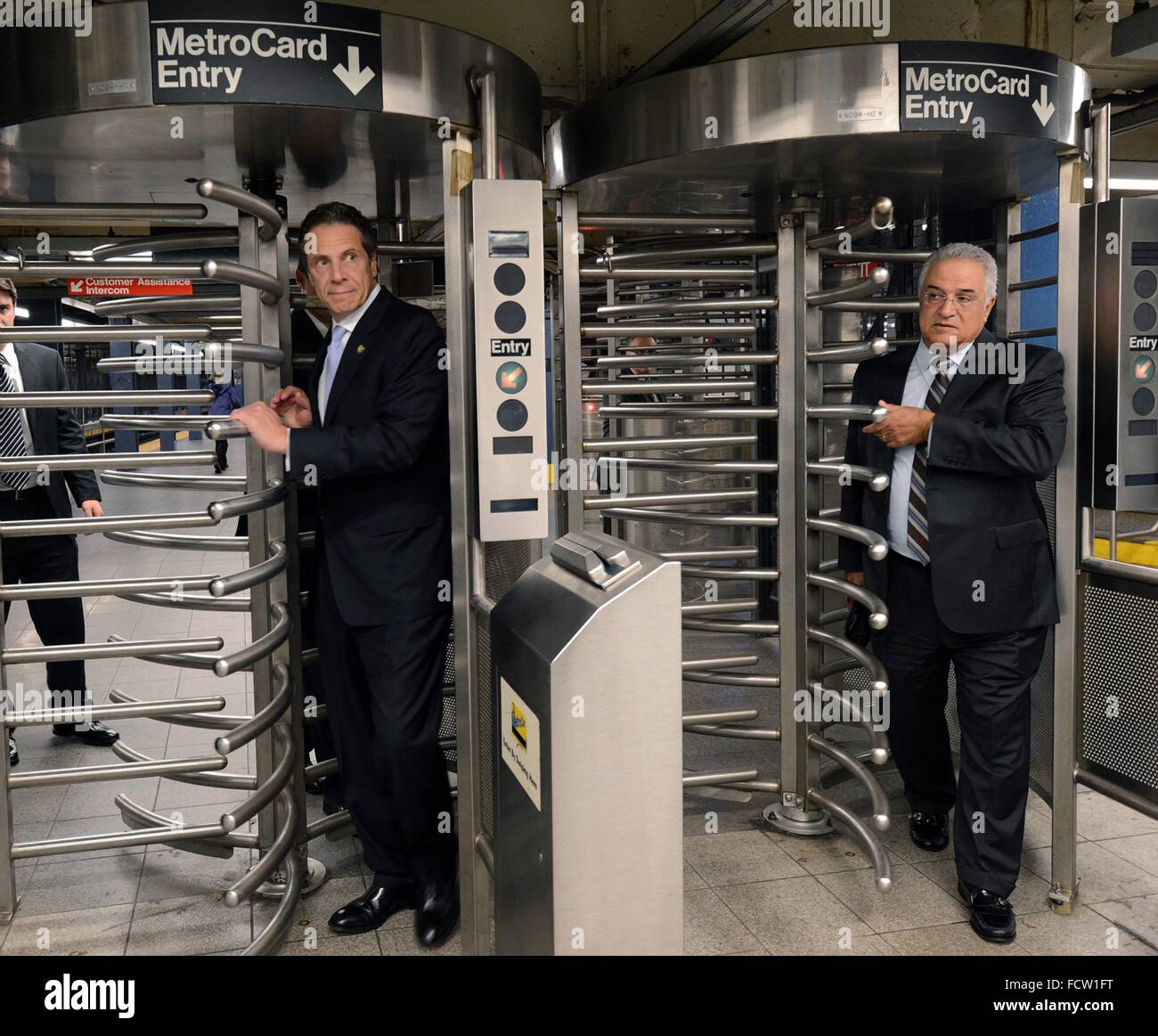 New York Governor Andrew Cuomo walks through a subway turnstile after riding the E train subway to assure New Yorkers - Stock Image