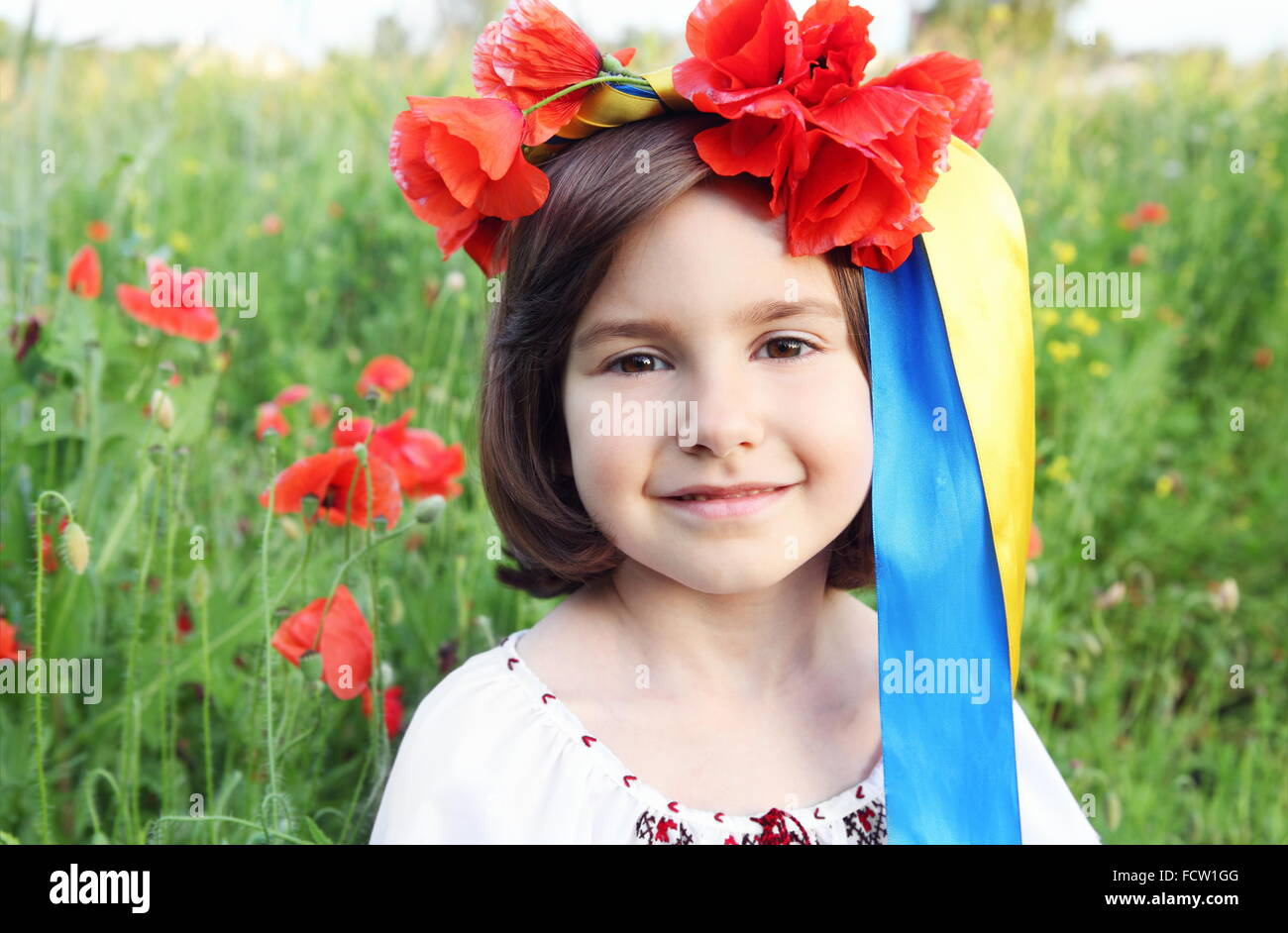 Smiling Girl on in Wreath with Yellow and Blue (Ukrainian Flag Colors) Ribbons - Stock Image