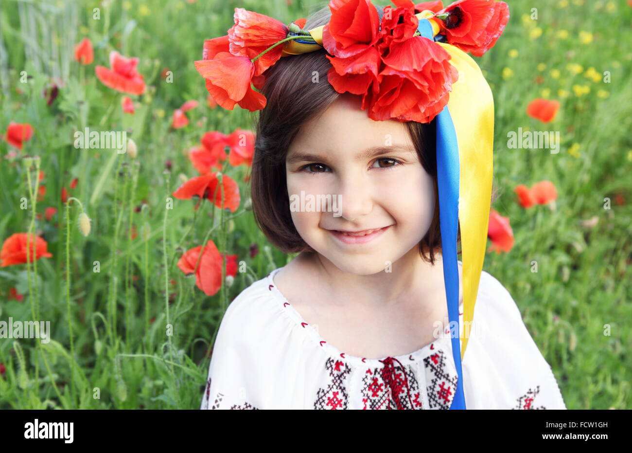 Girl on Meadow in Wreath with Yellow and Blue (Ukrainian Flag Colors) Ribbons - Stock Image
