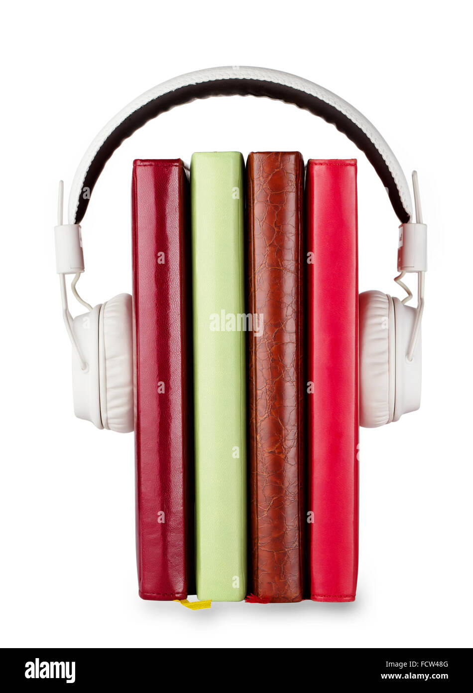 Concept of audio books on the subject with headphones and number of books - Stock Image