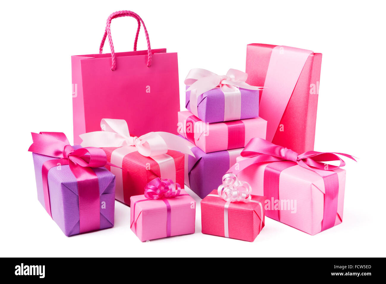 A collection of pink and purple Valentine's gifts with satin ribbons. - Stock Image