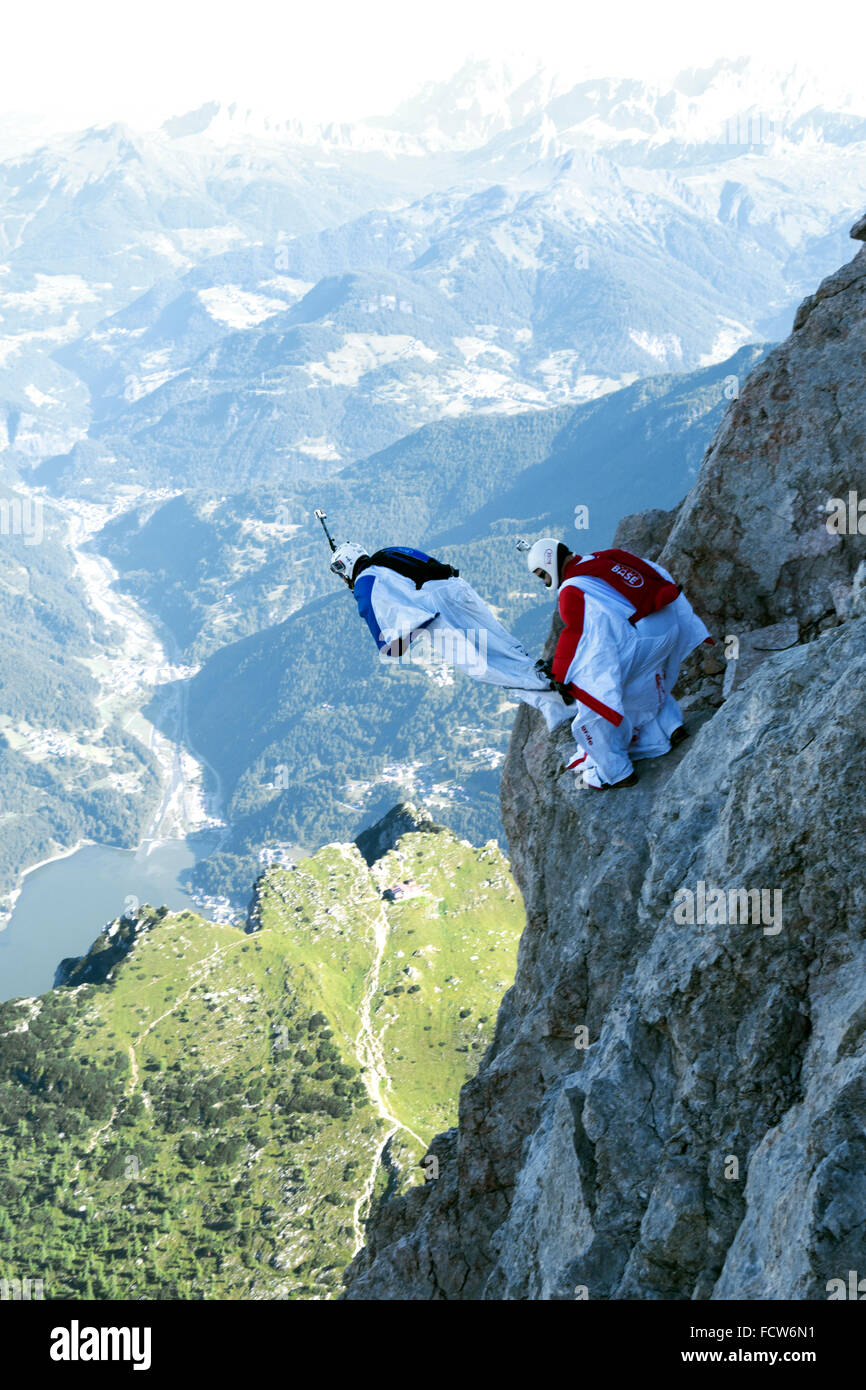 These two Wingsuit BASE jumpers are exiting from a cliff. Soon they'll fly together in a formation and soar - Stock Image