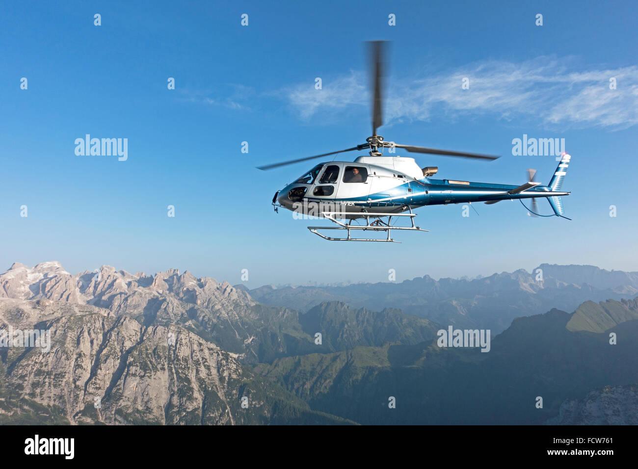 A helicopter scenic ride over the beautiful dolomites mountain on a perfect Summer morning - Stock Image