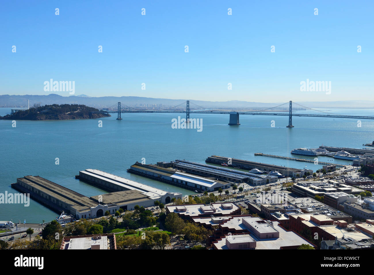 Elevated view of Bay Bridge and Ferry Terminals from Coit Tower on Telegraph Hill, San Francisco, California, USA - Stock Image