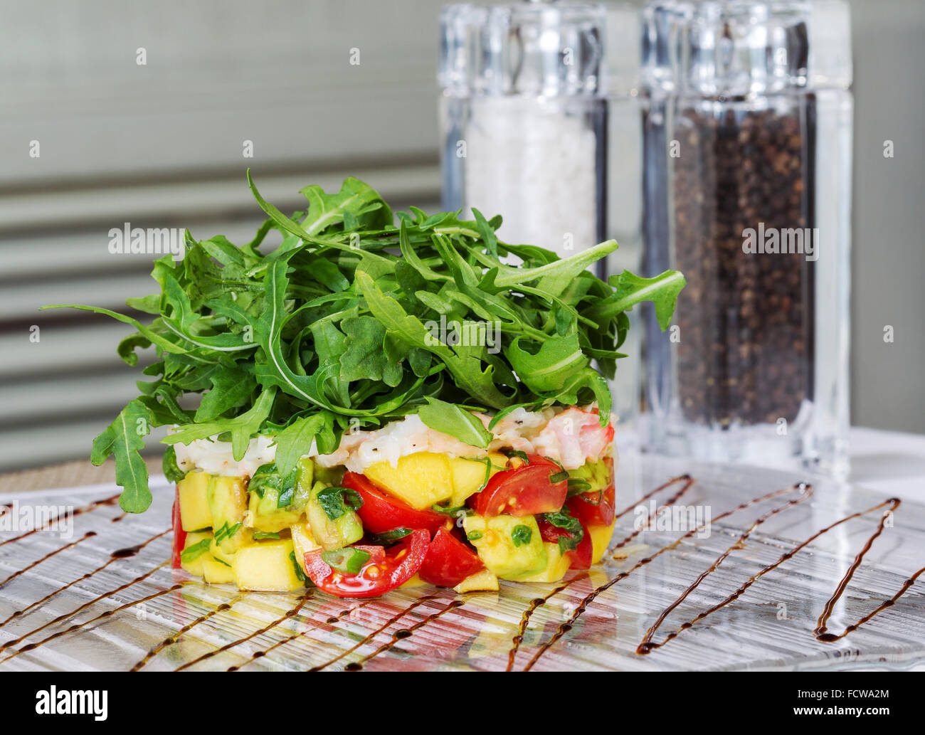 Fresh tomato and avocado with aromatic herbs Stock Photo