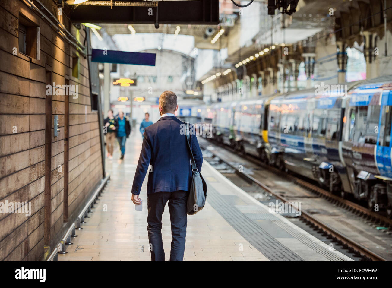 Businessman at the station - Stock Image