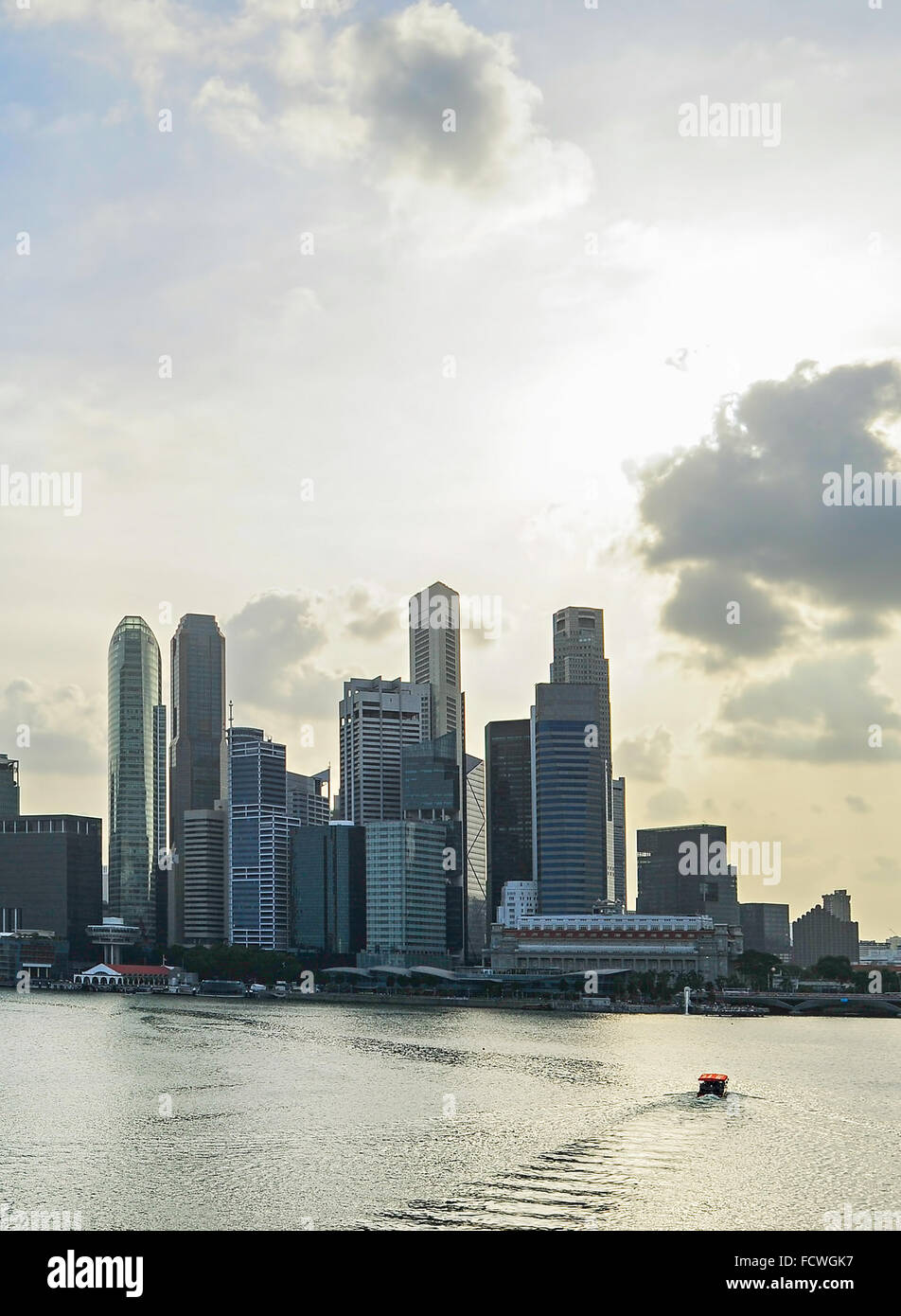 Skyline of Singapore bay with famous Downton Core at sunset. - Stock Image