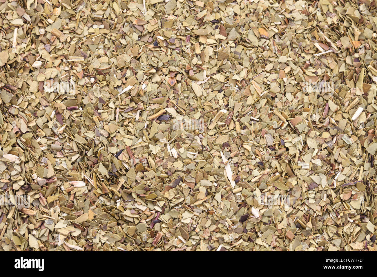 roasted mate tea leaves, close up shot - Stock Image