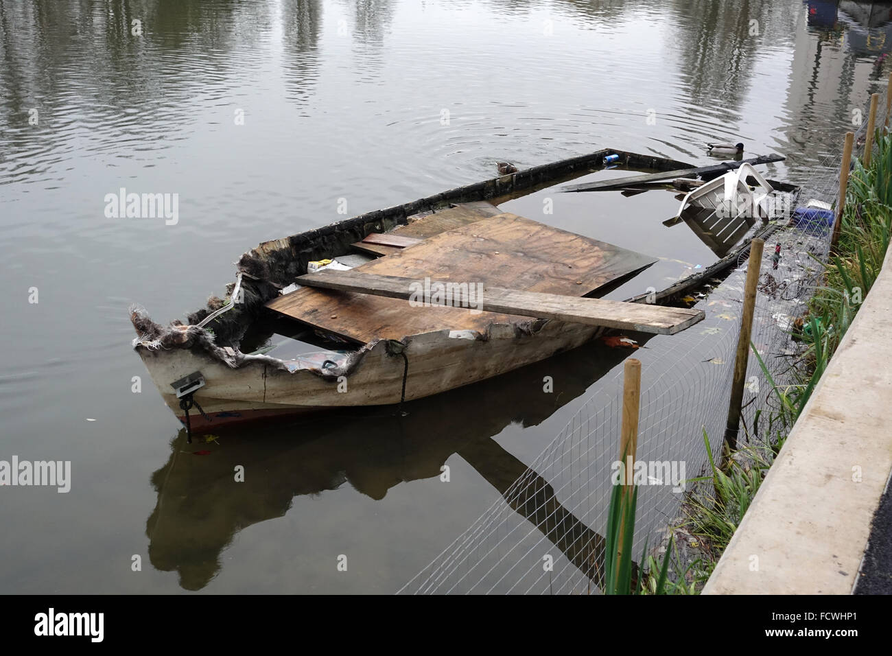 Derelict Boat in The Thames at Reading -1 - Stock Image
