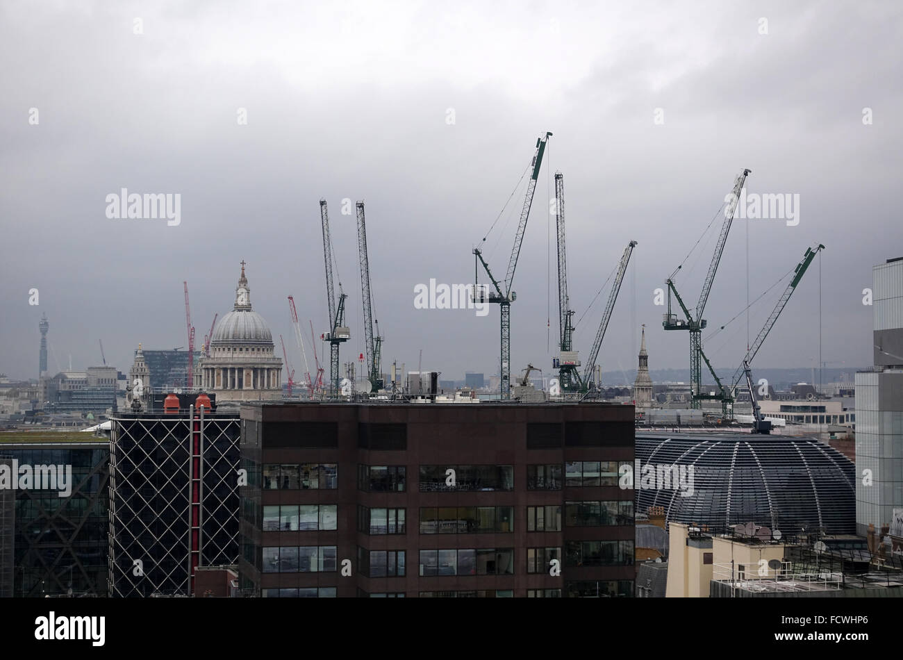 Cranes Towering over the London Skyline -1 - Stock Image