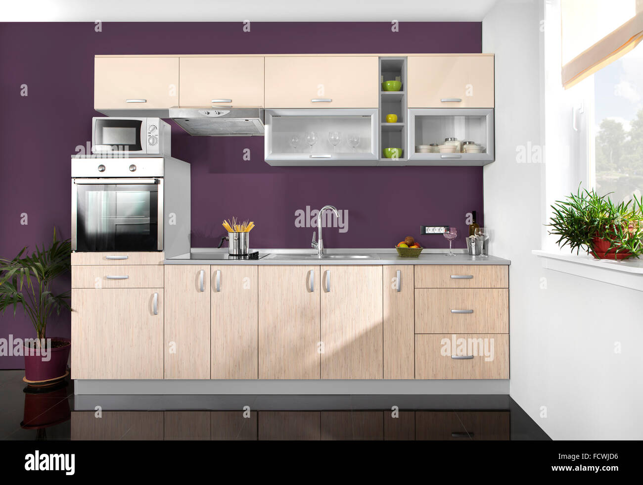 Interior of a modern kitchen, wooden furniture, simple and clean