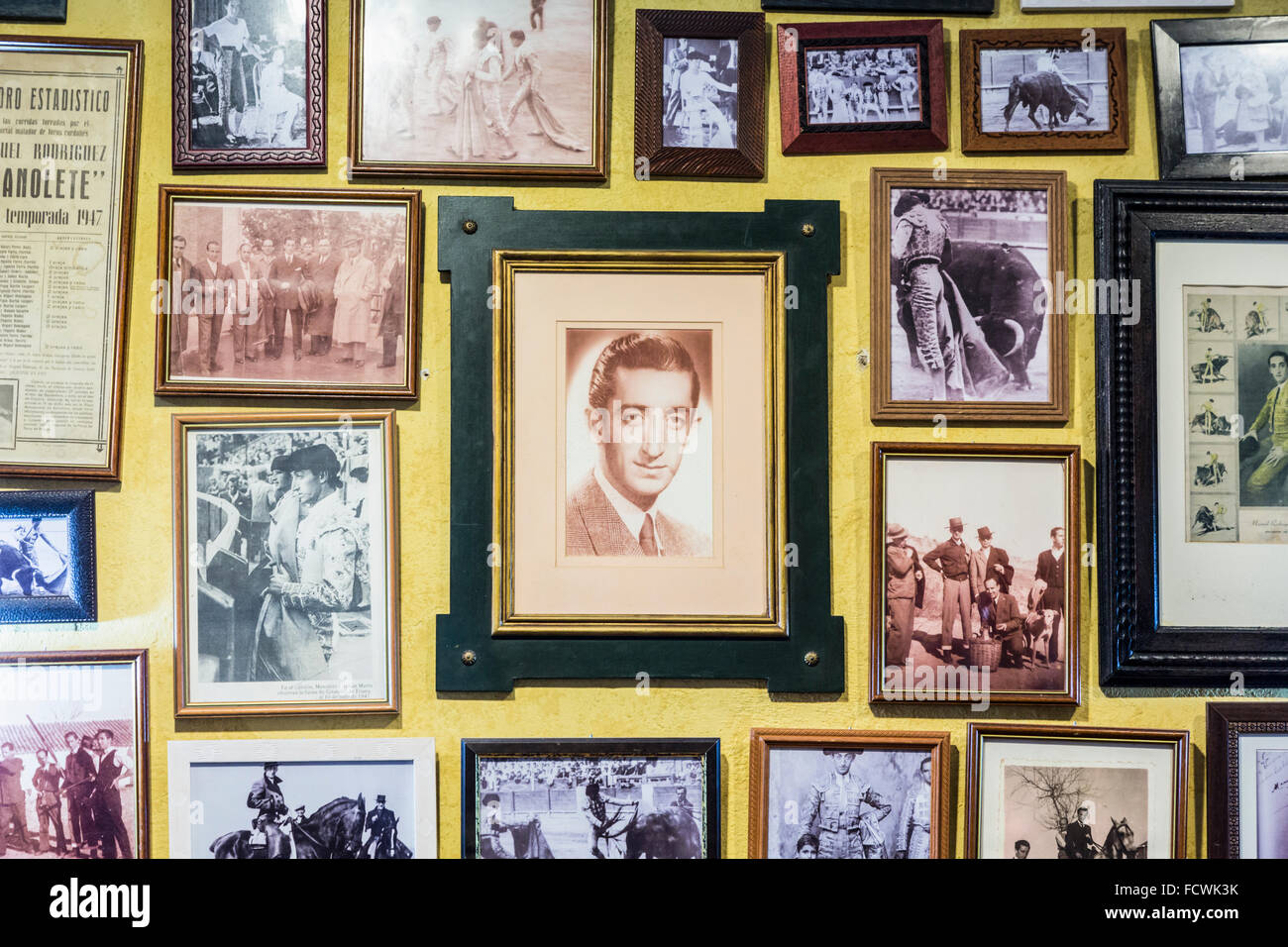 Cordoba, Cordoba Province, Spain.  Photographs of Spanish bullfighter Manolete in interior of Taberna las Comedias. - Stock Image