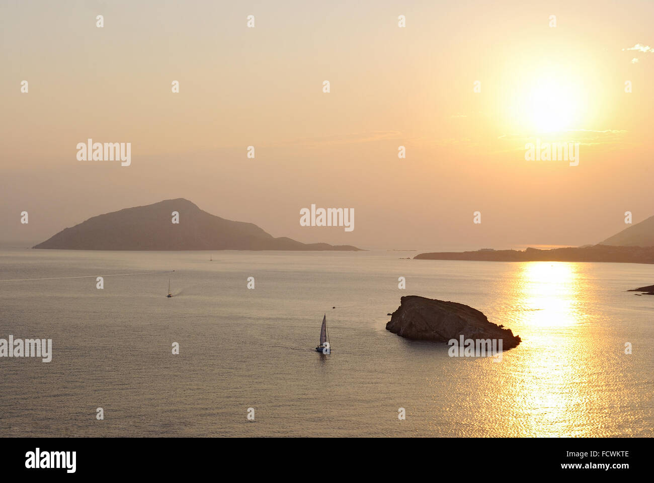 The magnificent golden sunset on the Aegean Sea at Cape Sounion. Greece. Stock Photo