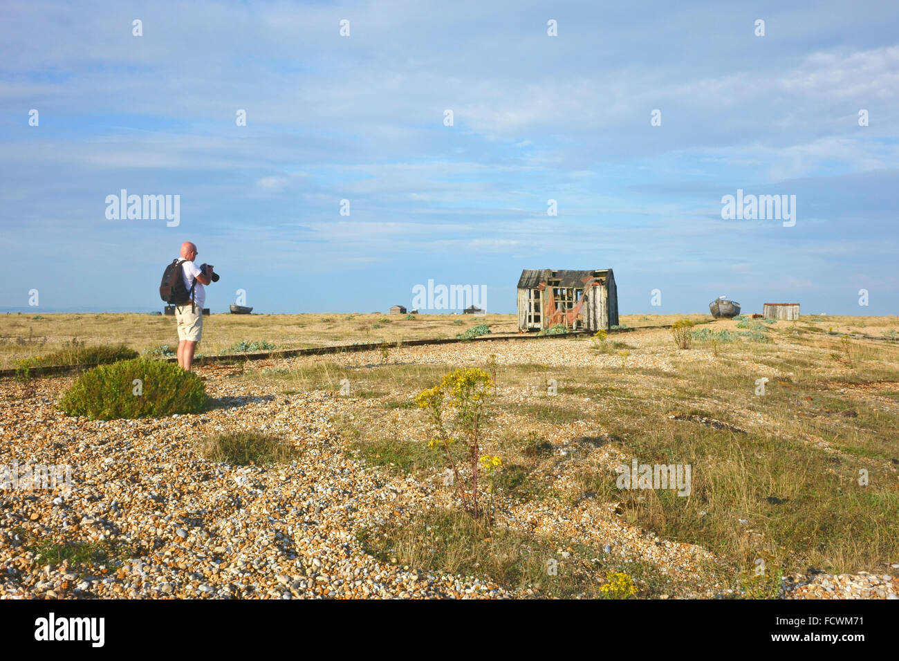 The bleak desolate landscape of Dungeness headland is a popular location for photographers - Stock Image