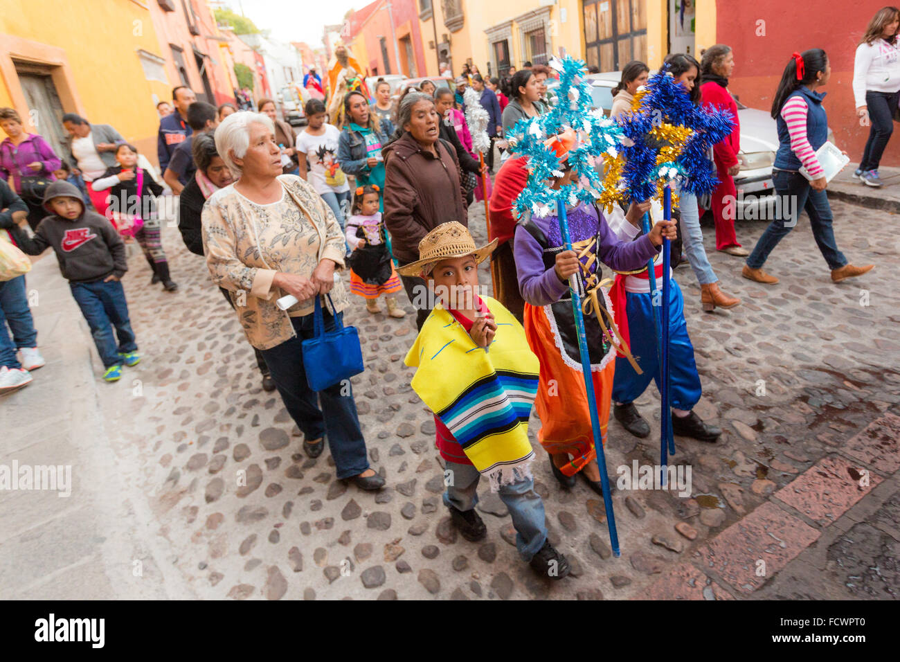 A procession of children lead the Three Kings through the cobble streets during El Dia de Reyes January 6, 2016 Stock Photo