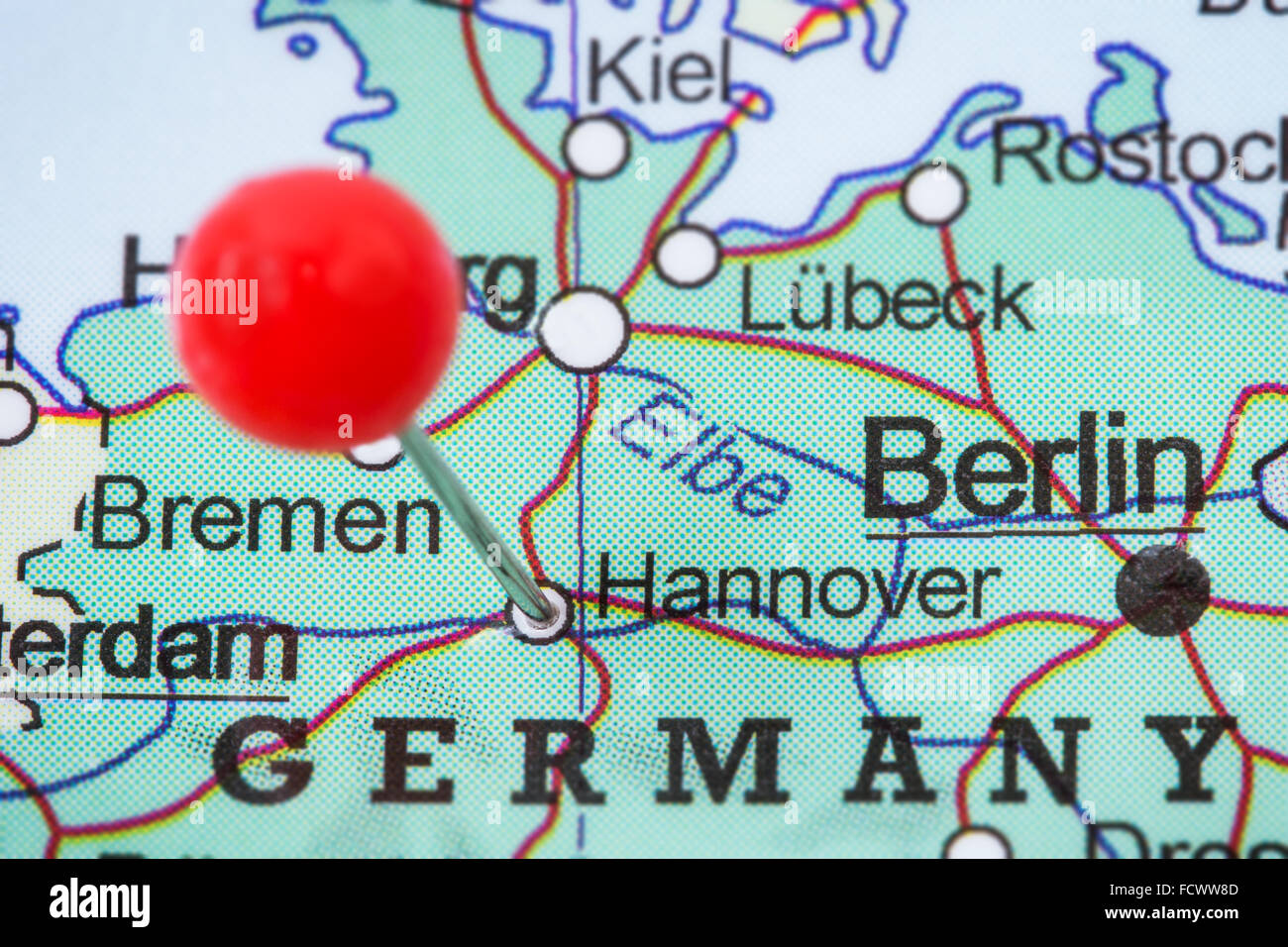 Closeup of a red pushpin in a map of Hannover Germany Stock Photo