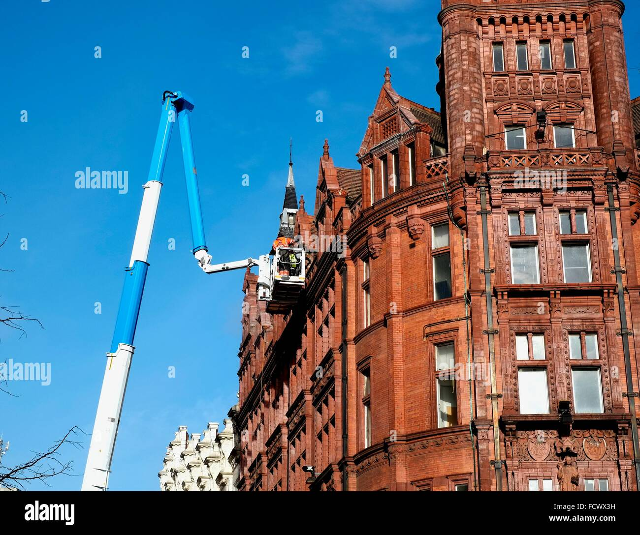 A Palfinger Platform P 480 being used to access the roof area of a building in Nottingham City centre - Stock Image