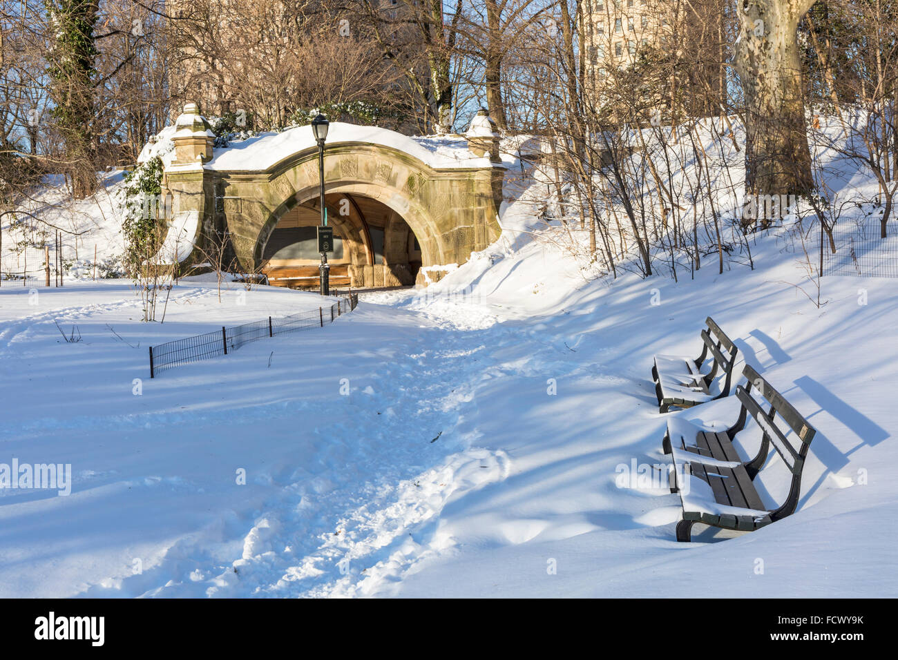 Park benches near Meadoport Arch covered in snow the morning after the blizzard of 2016 in Prospect Park, Brooklyn, - Stock Image