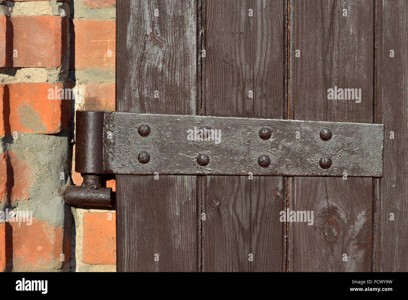 Ancient Door Hinge On Wooden Door Closeup   Stock Image