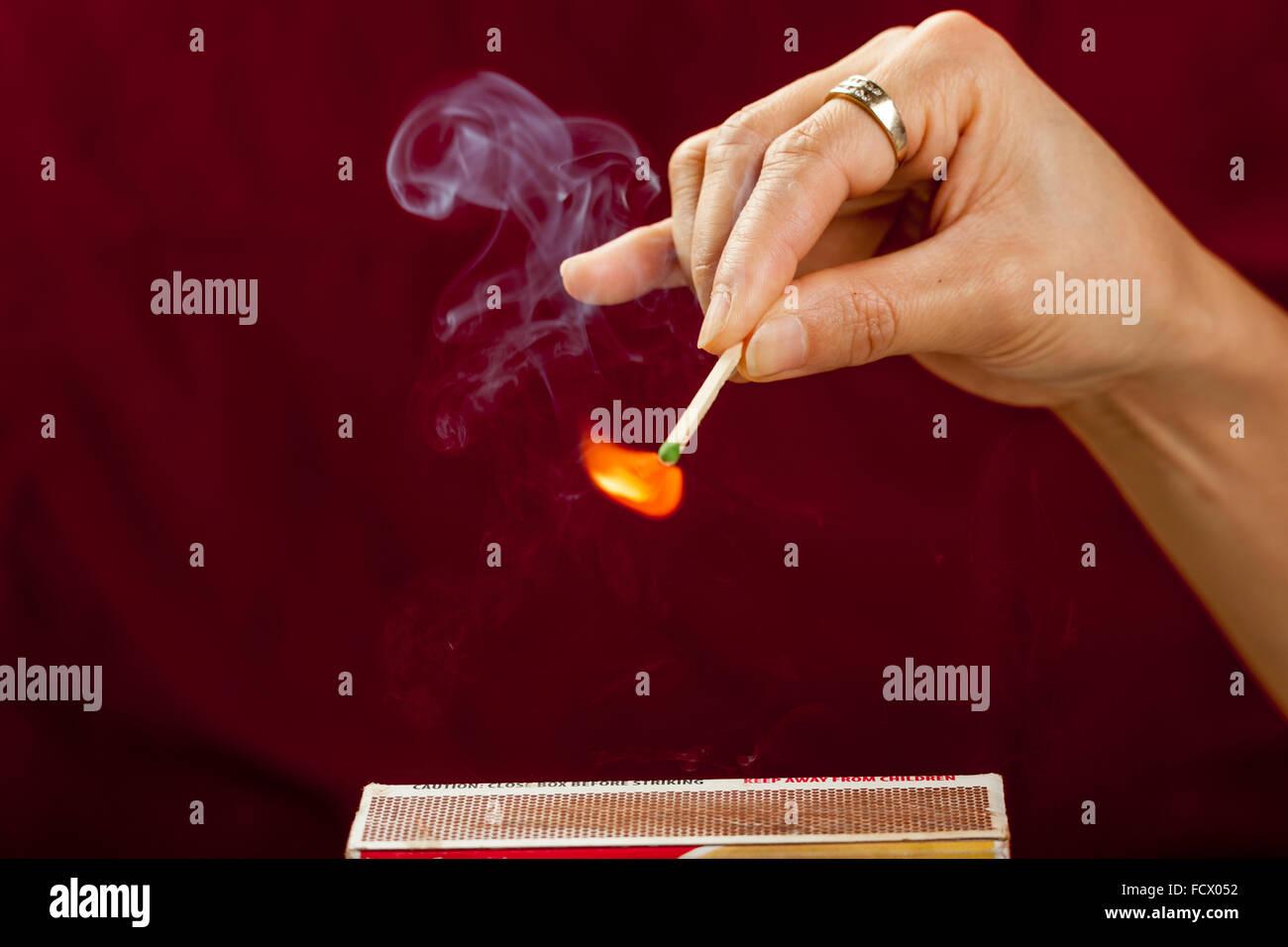Striking a match. - Stock Image
