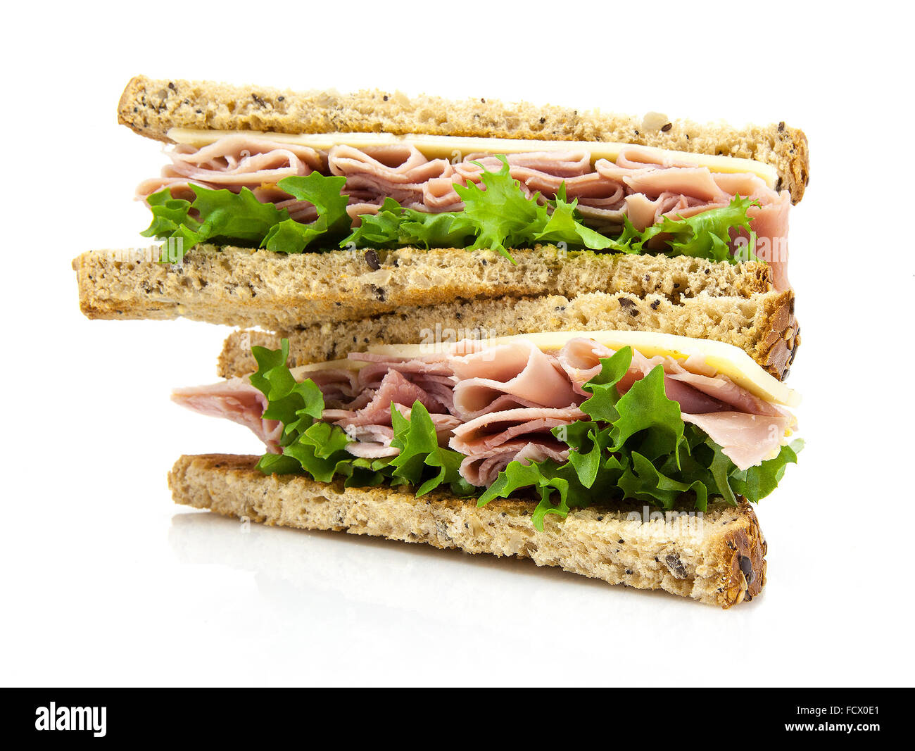 Fresh cut sandwich with ham, cheese and salad - Stock Image