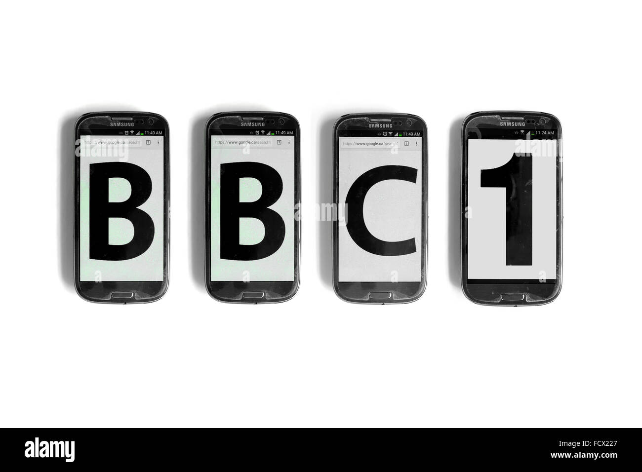 BBC1 written on the screens of smartphone photographed against a white background. - Stock Image