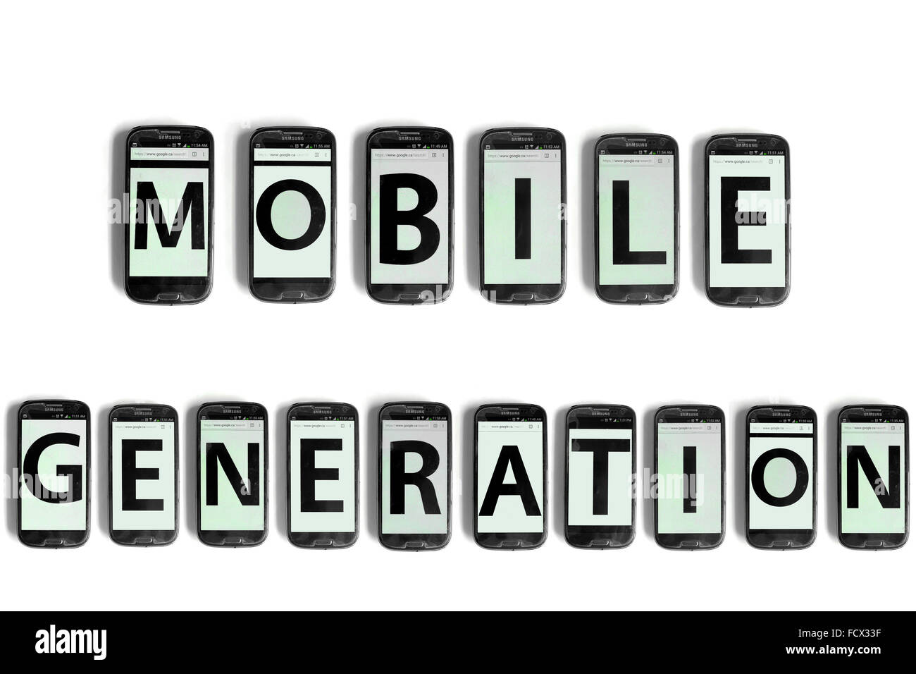 Mobile Generation written on the screen of smartphones photographed against a white background. - Stock Image