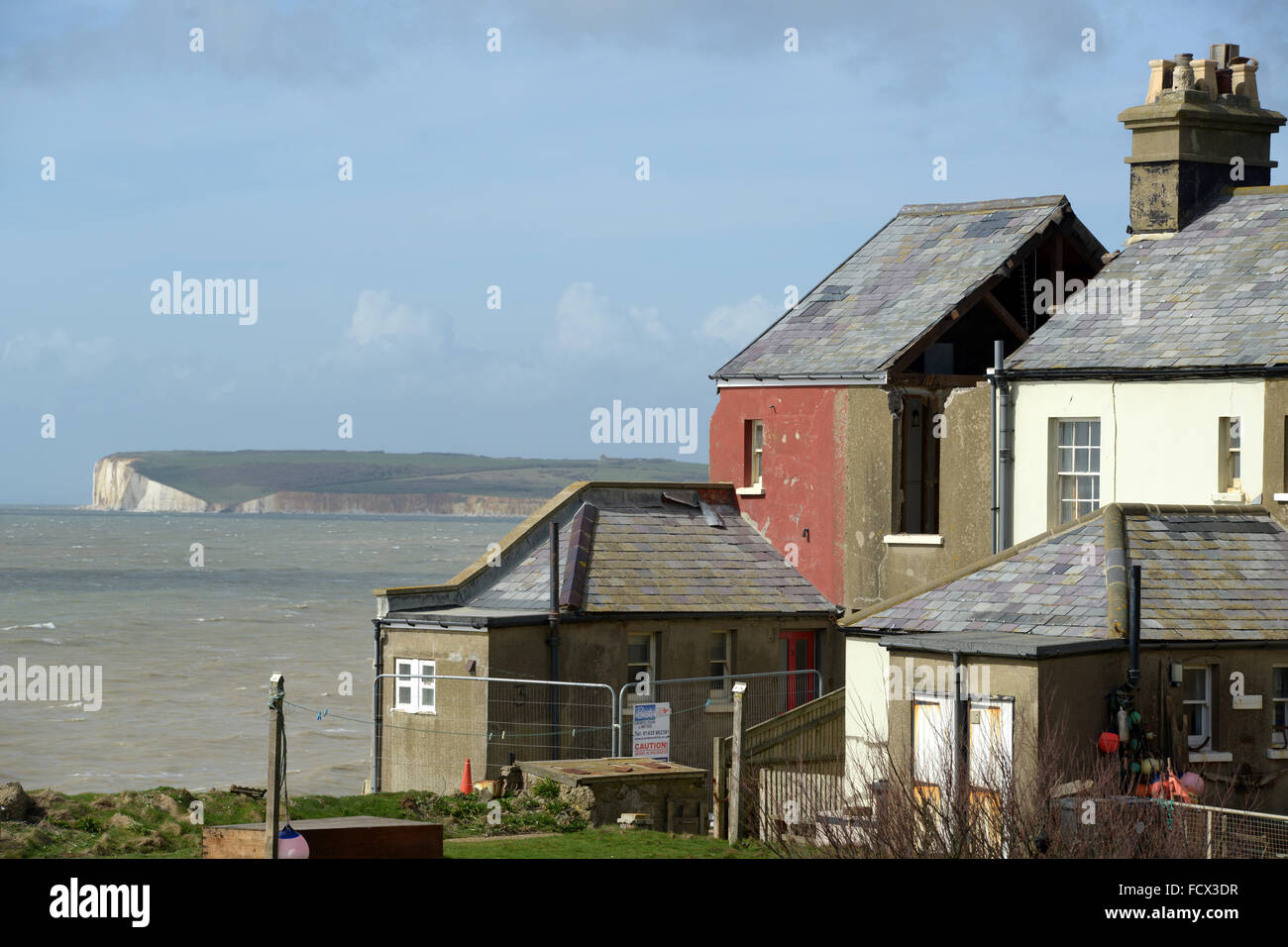 Demolition of Coastguard cottage at Birlng Gap, East Sussex, UK after winter storms eroded the chalk cliffs causing - Stock Image