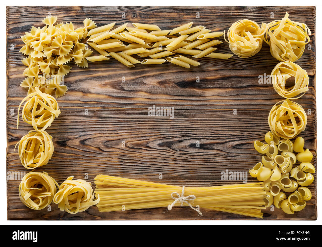 Variety of types and shapes of Italian pasta on wooden background. Stock Photo