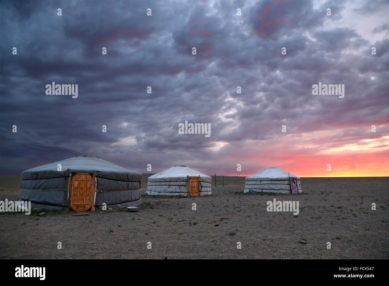 Sunrise and traditional yurts in Gobi desert -  Mongolia - Stock Image