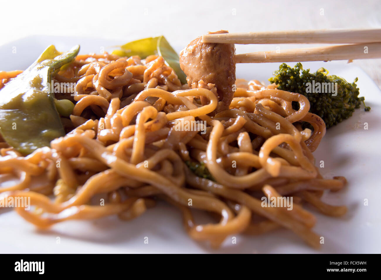 Chinese noodles vegetables, chicken and  chopsticks - Stock Image