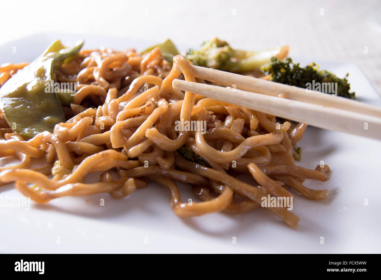 Chinese noodles vegetables and chopsticks - Stock Image