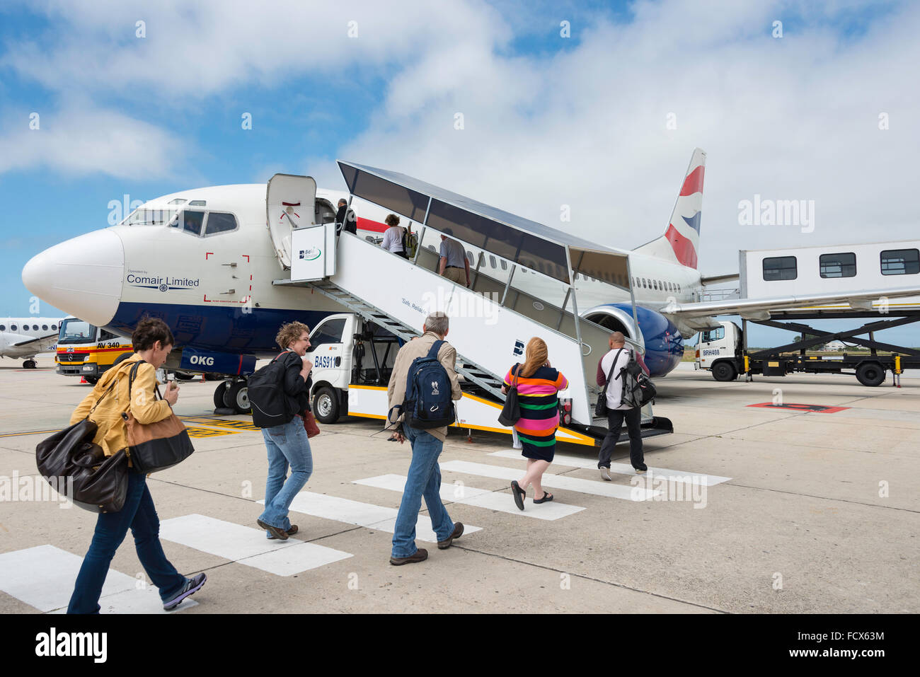 Passengers boarding Comair Boeing 737 aircraft, Port Elizabeth International Airport, Port Elizabeth, Eastern Cape, - Stock Image
