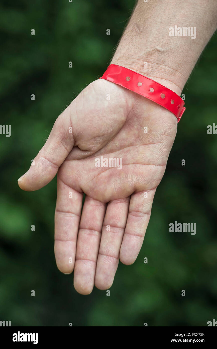 Asylum seekers at Lynx House in Cardiff, South Wales, were made to wear red wrist bands in order to claim food. - Stock Image
