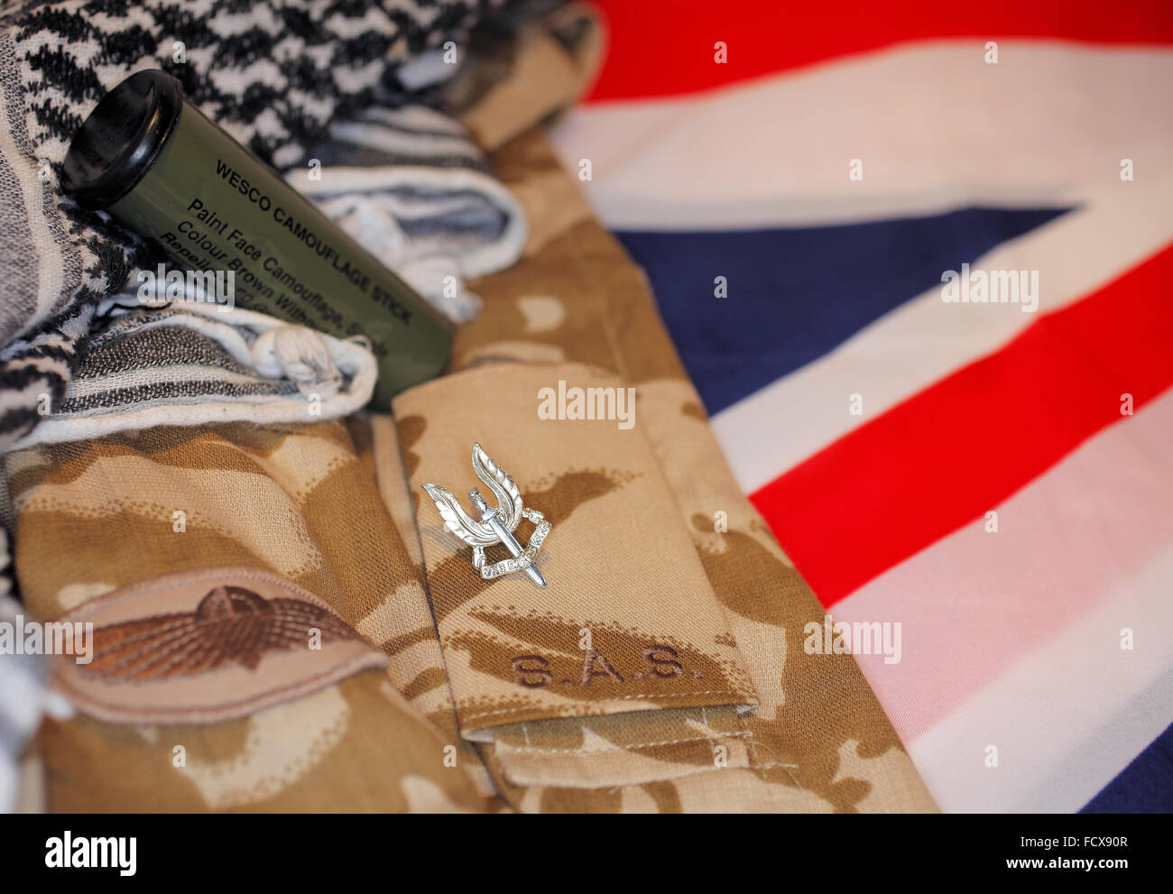 These Colours Don't Run.  British Army 22 S.A.S uniform against Union Jack background - Stock Image