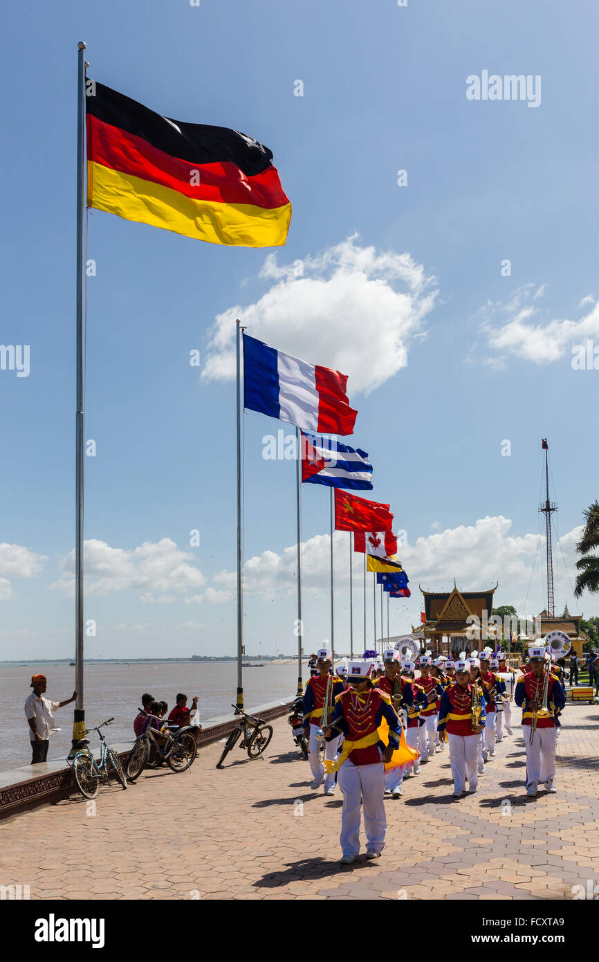 Chapel, music ensemble, boulevard with flags along river Tonlé Sap, Phnom Penh, Cambodia - Stock Image