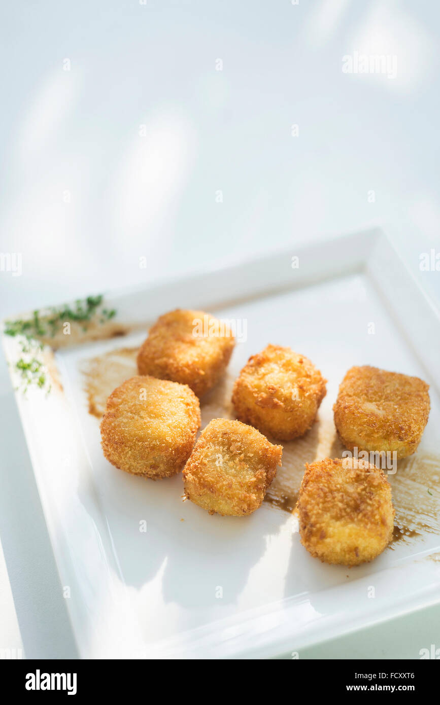 breaded fried potato and vegetable cubes croquettes - Stock Image