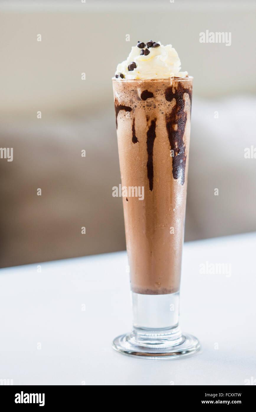 chocolate milk shake drink with whipped cream - Stock Image