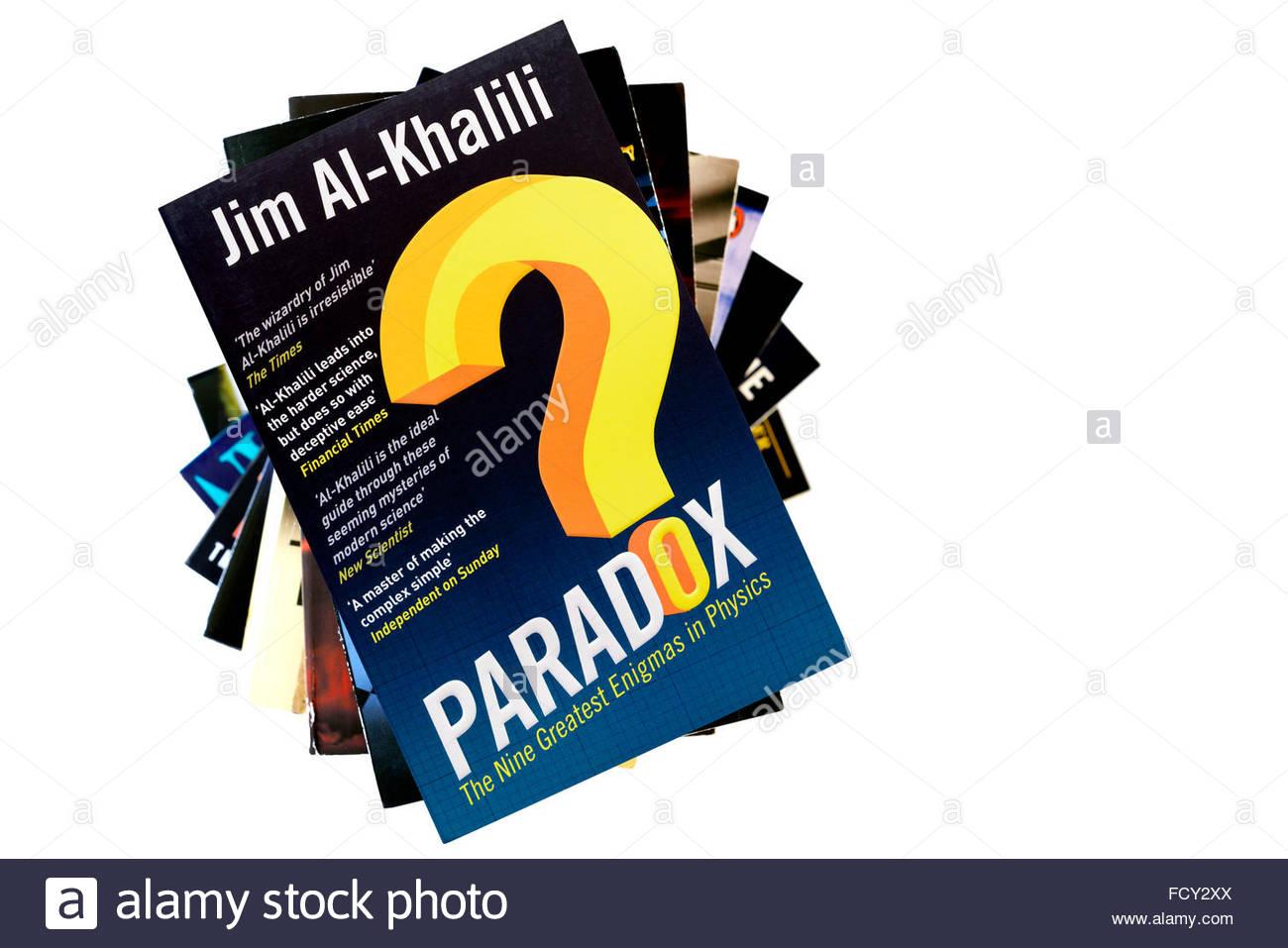 Jim Al-Khalili 2012 book Paradox: The Nine Greatest Enigmas, stacked used books, England - Stock Image