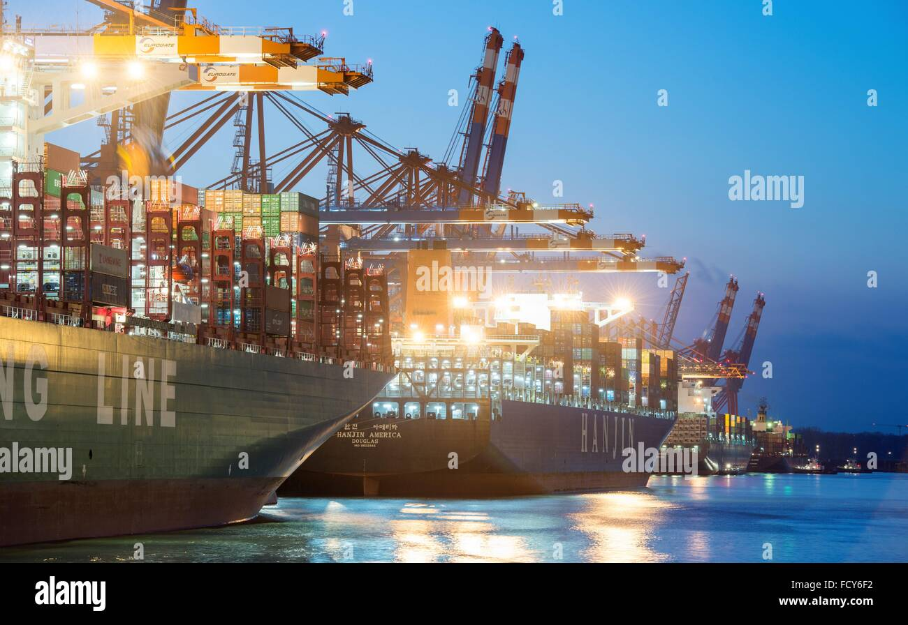 Cargo vessels are docked in the port of Hamburg, 20 January 2016 in Hamburg, Germany. - Stock Image