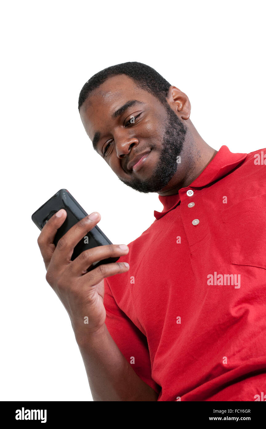 Black African American man using a cell phone for texting - Stock Image